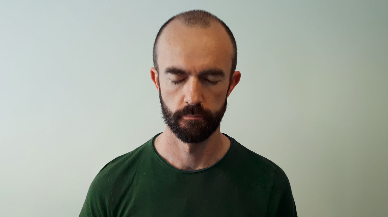 Seated man with eyes closed during a mindfulness meditation practice
